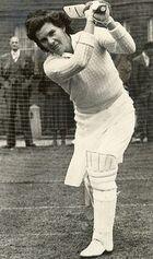 Black and white image of Betty Wilson batting