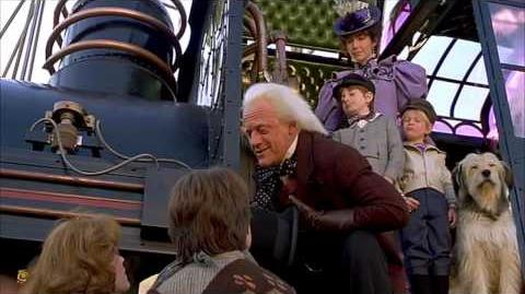 Creepy_Kid_from_Back_To_The_Future_3_points_to_his_flux_capacitor