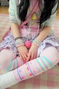 Pink-Lolita-Shirt-Mint-Cardigan-Layered-Lavender-Skirt-Multiple-Print-Socks-with-Rainbow-Layering-and-Pearl-Wrist-Bands-and-Necklaces-768x1152