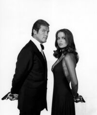 Barbara bach and roger moore promotional photo