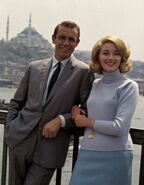 FROM RUSSIA WITH LOVE - James Bond (SEAN CONNERY) and Tatiana Romanova (DANIELA BIANCHI) stand together in front of a scenic background including the Hagia Sophia.
