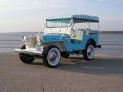 1964 Willys Jeep DJ-3A Surrey Gala in Blue.jpg