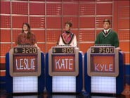 Jeopardy! 1991-1996 set with red backdrop and monitors