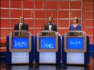 Jeopardy! 1991-1996 set with red backdrop and blue monitors