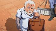 Pericolo holding a suitcase with Polpo's treasure