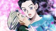 Yukako and Koichi embracing