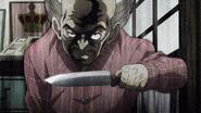 Yoshihiro pulls a knife