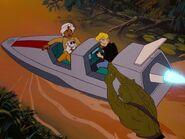 Reptillian holds Hadji and Jonny's boat