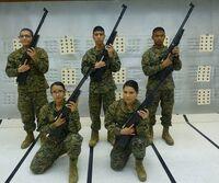 MCJROTC cadets holding air rifles