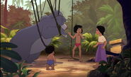 Mowgli is telling Shanti and Ranjan not to be scared of Baloo the bear