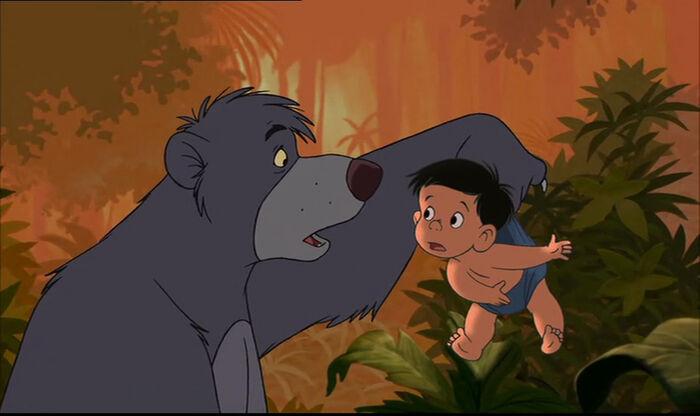 Ranjan is telling Baloo the bear Mowgli and Shanti are in danger.jpg