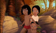 Mowgli is saveing Shanti and Ranjan from Shere Khan the tiger