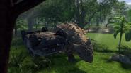 Ankylosaurus scratching against an overturned car