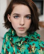 Kelly Malcolm-Curtis (Mckeena Grace)