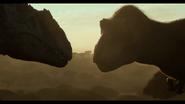 JWD Giganotosaurus vs feathered T-Rex