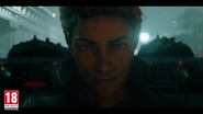Gabriela Morales standing in front of tanks in Ricos Rival trailer (closeup)