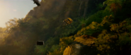JC4 3 cars falling near a jungle-covered cliff