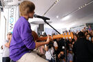 Justin playing guitar at Nintendo World Store 2009