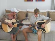 Jeremy and Justin playing guitar