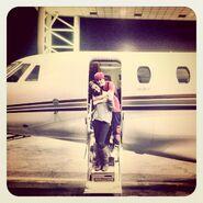 Justin Bieber hugging Selena Gomez on a jet