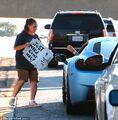 Justin giving homeless woman cash