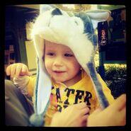 Jaxon wears wolf earflap hat