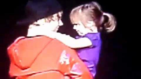 Justin Bieber brings his little sister, Jazmyn Bieber out on stage.