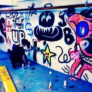 Justin Bieber globe on cross graffiti