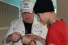 Justin Bieber showing Brett Andrews how to use his phone