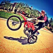 Justin Bieber on a dirtbike