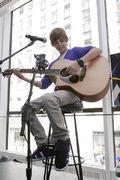 Justin Bieber playing guitar September 2009