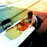 Ryan eating pizza on set