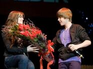 Justin Bieber gives flowers at his concert to Caitlin Beadles