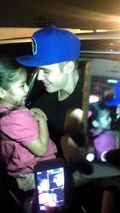 Justin Bieber holding a child 2014