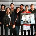 Justin Bieber holding What Do You Mean plaque