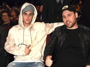 Justin Bieber and Scooter Braun at 2015 AMAs