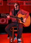 Justin Bieber playing the guitar at Carroll Middle School