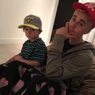 Justin Bieber and Jaxon Bieber wearing hats
