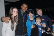 Justin Bieber with his friends and Usher