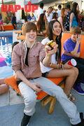 Justin Bieber holding a water gun March 2010
