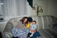 Young Justin Bieber with his mom and a baby