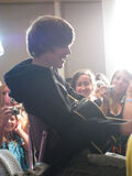 Justin playing for a huge crowd at Q100, July 2009