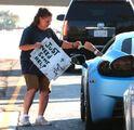 Justin giving homeless woman money