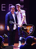Justin BIeber holding a Gibson guitar