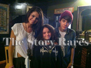 Justin Bieber and Selena Gomez with a fan