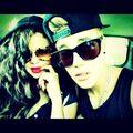 Justin and Selena taking picture together