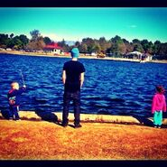 Justin with siblings at lake