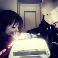 Jazzy holding hands with Jaxon