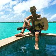 Justin with his guitar in Bora Bora