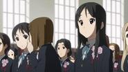 Keiko passing Mio's message to Michiko